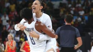 Aug 20, 2016; Rio de Janeiro, Brazil; USA forward/guard Angel Mccoughtry (8) and USA guard Diana Taurasi (12) celebrate after beating Spain in the women's basketball gold medal match during the Rio 2016 Summer Olympic Games at Carioca Arena 1. Mandatory Credit: Jeff Swinger-USA TODAY Sports