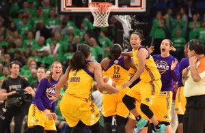 The Los Angeles Sparks celebrate their 77-76, victory over the Minnesota Lynx in game 5 of the WNBA Championship game at Target Center on Thursday, October 20, 2016. (Pioneer Press: John Autey)